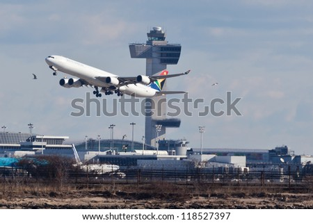 NEW YORK - OCT. 8: SAA A340 climbs after take off from JFK airport located in New York, USA on October 8, 2012 South African Airways is national flag carrier and largest airline of South Africa - stock photo