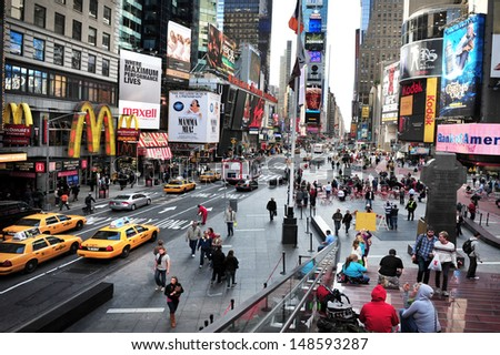 NEW YORK - OCT 08 2010:Traffic on Time Square in Manhattan, New York City.It's one of the world's busiest pedestrian intersections and a major center of the world's entertainment industry. - stock photo