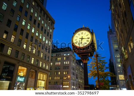 NEW YORK - OCT31: Trump Tower Clock at  Fifth Avenue, New York City at twilight on Oct 31, 2015. New York City is the most densely populated city in the United States. - stock photo