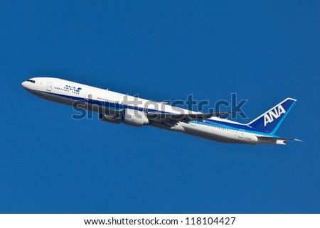 NEW YORK - OCTOBER 4: A Boeing 777 ANA approaching to JFK in New York, USA on October4, 2012. ANA is largest airline in Japan and serve 49 destinations in Japan and 35 international routes - stock photo