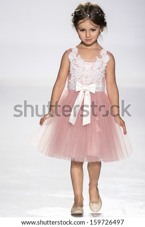 NEW YORK - OCTOBER 5: A model walks the runway at Dorian Ho preview during the Swarovski at petitePARADE NY Kids Fashion Week in Collaboration with Vogue Bambini on  OCTOBER 5, 2013 in New York - stock photo