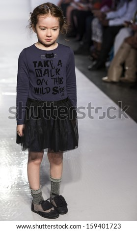 NEW YORK - OCTOBER 5: A model walks the runway at IKKS Junior preview during the Swarovski at petitePARADE NY Kids Fashion Week in Collaboration with Vogue Bambini on  OCTOBER 5, 2013 in New York - stock photo