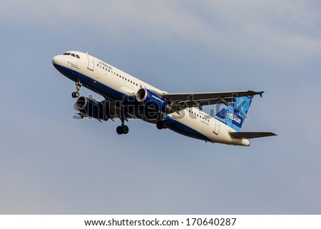 NEW YORK - OCTOBER 9: Airbus A320 JetBlue takes off from from JFK Airport on October 9, 2013 in New York, USA. Airbus A320 the first narrow body airliner is the biggest competition to Boeing 737NG. - stock photo
