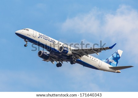 NEW YORK - OCTOBER 9: Embraer 190 JetBlue departs from JFK Airport in New York, USA on October 9, 2013. JetBlue is New York based, fastest growing airline in the world. They use Airbuses and Embraers. - stock photo