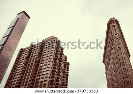 New York - October 5: Facade of Flatiron Building in Day 5 October 2015 year. Upon completion in 1902 year, it was one of the tallest buildings in the city at 20 floors high. - stock photo