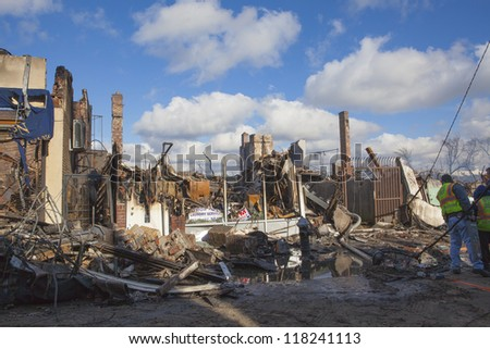 NEW YORK - October 31: Homes sit smoldering after Hurricane Sandy  in the Far Rockaway area  on October 30; 2012 in New York City; NY - stock photo