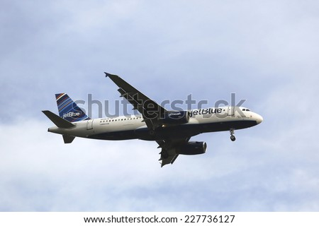 NEW YORK -OCTOBER 28:JetBlue Airbus A320 in New York sky before landing at JFK Airport on October 28, 2014. JetBlue Airways is an American low-cost airline with main base at JFK International Airport  - stock photo