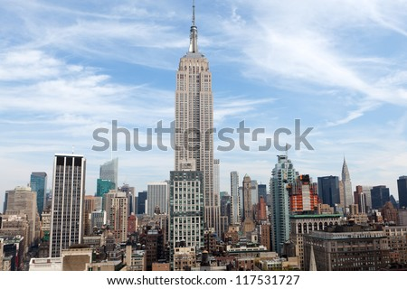 NEW YORK - OCTOBER 6: The Empire State Building on October 6, 2012 in NYC. The Empire State Building is a 102-story landmark and American cultural icon in New York City. - stock photo
