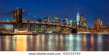 New York - Panoramic view of Manhattan Skyline with skyscrapers  and famous Brooklyn Bridge by night, big size  - stock photo