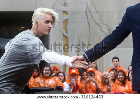 NEW YORK-SEP 10: Singer Justin Bieber shakes hands with Matt Lauer (not pictured) on NBC's 'TODAY Show' at Rockefeller Plaza on September 10, 2015 in New York City. - stock photo