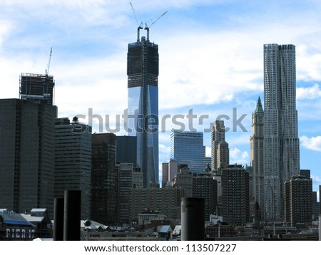 NEW YORK - SEPT 16. Afternoon view of the Freedom Tower and Downtown Manhattan skyline pictured on September 16 2012, from the newly created Brooklyn Bridge Park, Brooklyn, NYC. - stock photo