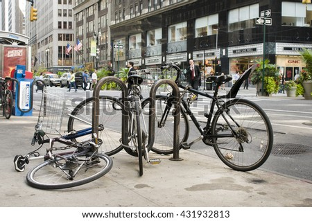 NEW YORK - SEPT 30: Chained bicycles near Broadway Ave. in a typical Manhattan scene on September 30, 2013 in New York, USA.  - stock photo