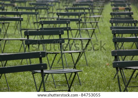 NEW YORK - SEPT 11: 2,753 chairs in Bryant Park facing Ground Zero commemorate victims who perished in the attacks on the World Trade Center buildings on 9/11 on September 11, 2011 in New York. - stock photo