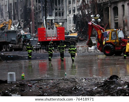 NEW YORK - SEPT 20 :  Four NYFD Fire Fighters at Ground Zero World Trade Centre on September 20, 2001 in New York. - stock photo