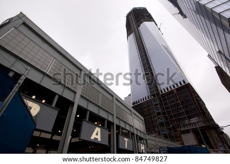 NEW YORK - SEPT 11: PATH subway entrance near the base of One World Trade Center building (Tower 1) on the 10th anniversary of the terrorist attacks on September 11, 2011 in New York. - stock photo