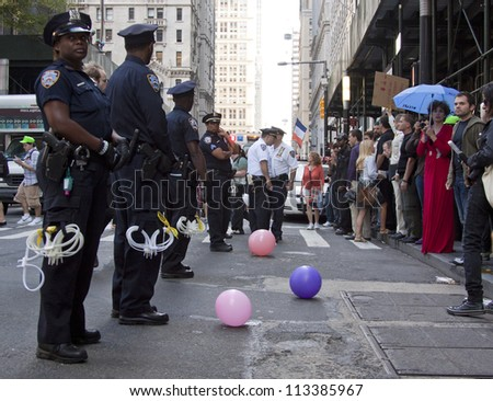 NEW YORK - SEPT 17: Police face protesters assembled on the sidewalk on Broadway near Wall St during the 1yr anniversary of the Occupy Wall St protests on September 17, 2012 in New York City, NY. - stock photo