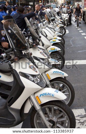 NEW YORK - SEPT 17: Police motorcycles parked on Broadway in front of Zuccotti Park on the 1yr anniversary of the Occupy Wall St protests on September 17, 2012 in New York City, NY. - stock photo