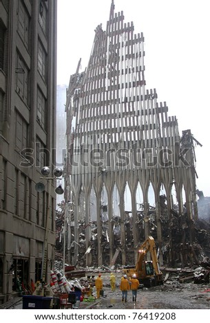 NEW YORK - SEPT 20 :  Workers clear up the debris at Ground Zero World Trade Centre on September 20, 2001 in New York. - stock photo