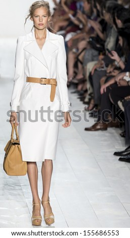 NEW YORK - SEPTEMBER 11: A model is walking the runway at Michael Kors Collection for Spring Summer 2014 fashion show during Mercedes-Benz Fashion Week on SEPTEMBER 11, 2013 in New York - stock photo