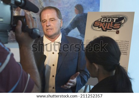 NEW YORK - SEPTEMBER 9:  Former New York Ranger Rod Gilbert speaks as he attends the Ace Bailey Children's Foundation Ace's Got Skills event at the Chelsea Piers Skyrink September 9, 2004 in NY. - stock photo
