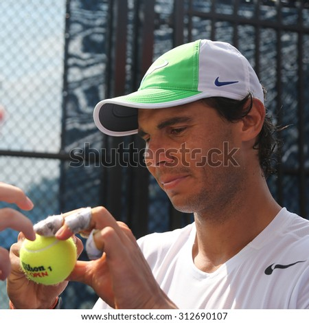 NEW YORK - SEPTEMBER 1, 2015: Fourteen times Grand Slam champion Rafael Nadal of Spain signing autographs after practice for US Open 2015 at Billie Jean King National Tennis Center in New York - stock photo