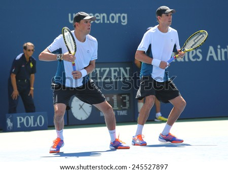 NEW YORK -SEPTEMBER 4, 2014: Grand Slam champions Mike and Bob Bryan during US Open 2014 semifinal doubles match at Billie Jean King National Tennis Center in New York - stock photo