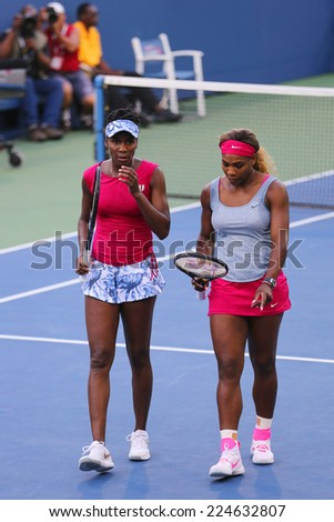 NEW YORK - SEPTEMBER 2: Grand Slam champions Serena Williams and Venus Williams during quarterfinal doubles match at US Open 2014 at National Tennis Center on September 2, 2014 in New York - stock photo