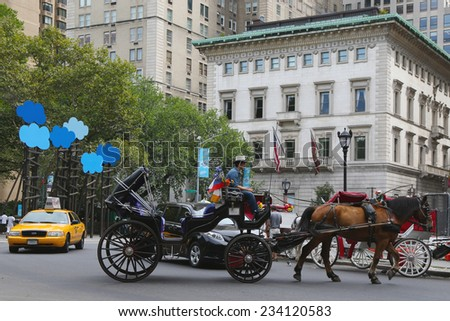 NEW YORK - SEPTEMBER 8: Horse Carriage near Central Park on 59th Street on September 8, 2014 in Manhattan. Horse-Drawn Carriages are a wonderful way to experience the beauty of the Park - stock photo