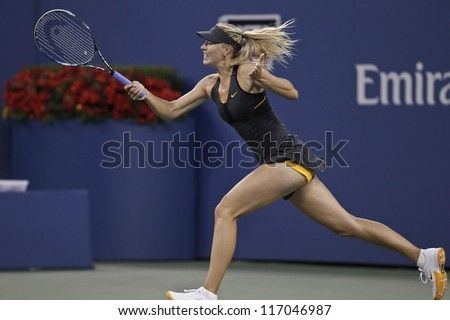 NEW YORK - SEPTEMBER 2: Maria Sharapova of Russia returns ball during 4th round match against Nadia Petrova of Russia at US Open tennis tournament on September 2, 2012 in Flushing Meadows New York - stock photo