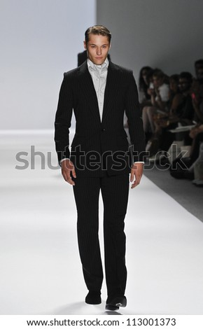 NEW YORK - SEPTEMBER 09: Model walks runway for Zang Toi presentation during Spring/Summer 2013 at Mercedes-Benz Fashion Week on September 9, 2012 in New York - stock photo