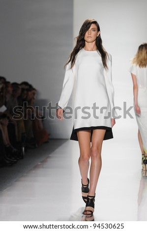 NEW YORK - SEPTEMBER 14: Model walks the runway at the J. Mendel Spring/Summer 2012 collection during New York Fashion Week on September 14, 2011 in New York City. - stock photo