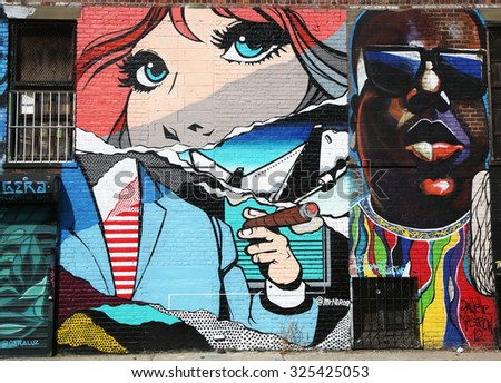 NEW YORK - SEPTEMBER 20, 2015: Mural art at East Williamsburg in Brooklyn. Outdoor art gallery known as the Bushwick Collective has most diverse collection of street art in Brooklyn - stock photo