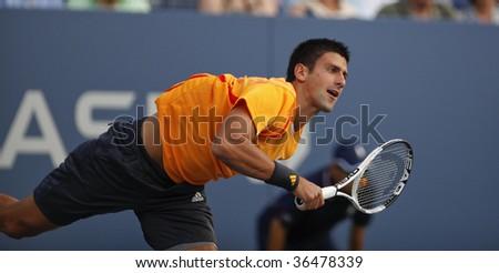 NEW York - September 3: Novak Djokovic of Serbia returns a shot during 2nd round match against Carsten Ball of Australia at US Open on September 3 2009 in New York - stock photo