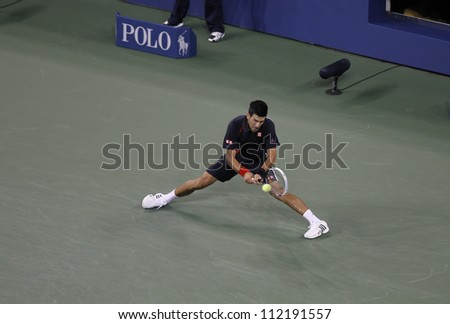 NEW YORK - SEPTEMBER 6: Novak Djokovic of Serbia returns ball during Quarterfinal match against Juan Martin Del Potro of Argentina at US Open tennis tournament on September 6, 2012 in New York - stock photo