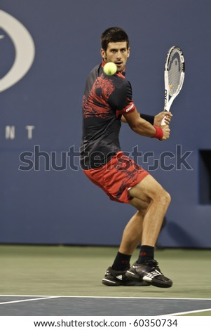 NEW YORK - SEPTEMBER 04: Novak Djokovic of Serbia returns ball during third round match against James Blake of USA at US Open tennis tournament on September 04, 2010, New York. - stock photo