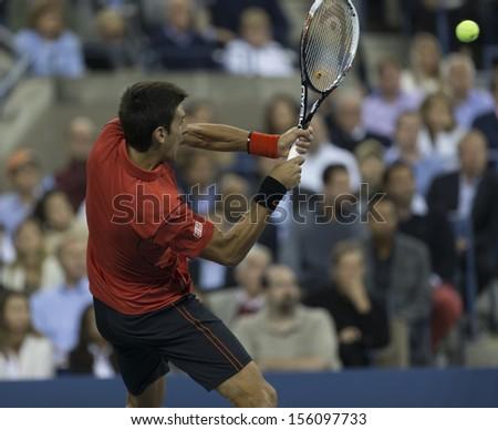 NEW YORK - SEPTEMBER 9: Novak Djokovic of Serbia returns ball during US Open final match against Rafael Nadal of Spain at USTA Billie Jean King National Tennis Center on September 9, 2013 in NYC - stock photo