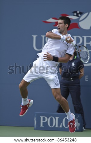 NEW YORK - SEPTEMBER 10: Novak Djokovic of Serbia returns during semifinal match against Roger Federer of Switzerland at USTA Billie Jean King National Tennis Center on September 10, 2011 in New York City - stock photo