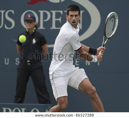 NEW YORK - SEPTEMBER 10: Novak Djokovic of Serbia returns during semifinal match against Roger Federer of Switzerland at USTA Billie Jean King National Tennis Center on September 10, 2011 in NYC - stock photo