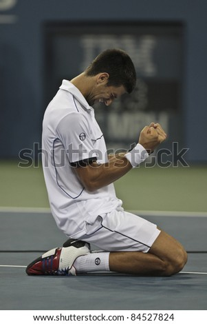 NEW YORK - SEPTEMBER 12: Novak Djokovic of Serbia winner of US Open single men championships reacts after final match against Rafael Nadal of Spain at US Open on September 12, 2011 in NYC - stock photo