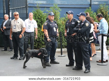 NEW YORK - SEPTEMBER 13, 2015: NYPD  police officers and K-9 dog providing security at National Tennis Center during US Open 2015 finals in New York - stock photo