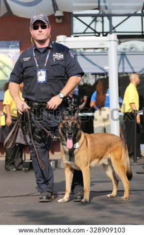 NEW YORK - SEPTEMBER 1, 2015: NYPD transit bureau K-9 police officer and Belgian Shepherd K-9 Wyatt providing security at National Tennis Center during US Open 2015 in New York - stock photo