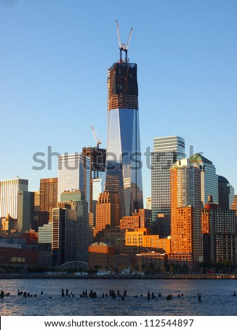 NEW YORK - SEPTEMBER 11: One World Trade Center seen under construction September 11, 2012 in New York City, on the 11th anniversary of the 9/11 terror attacks. - stock photo