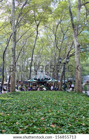 NEW YORK -SEPTEMBER 03: People enjoying a nice evening in Bryant Park on September 03, 2013 in New York City, NY. Bryant Park is a 9,603 acre privately managed park in the center of Manhattan  - stock photo