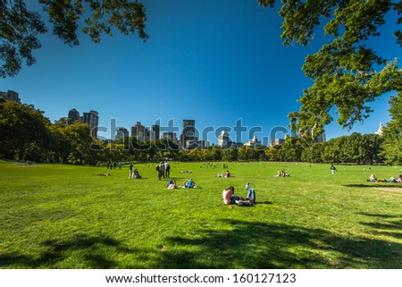 NEW YORK - September 24: People enjoying relaxing outdoors in Central Park on Sept. 24, 2013 in New York. The park is the most visited urban park in the United States with 35 million visitors annually - stock photo