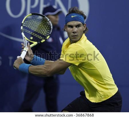 NEW YORK - SEPTEMBER 10: Rafael Nadal of Spain returns a shot during quarterfinal round match against Fernando Gonzalez of Chile at US Open on September 10 2009 in Flushing, New York. - stock photo
