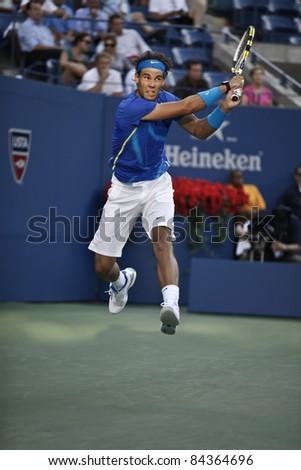 NEW YORK - SEPTEMBER 09: Rafael Nadal of Spain returns ball during quarterfinal match against Andy Roddick of USA at USTA Billie Jean King National Tennis Center on September 09, 2011 in NYC - stock photo