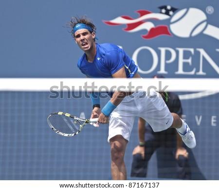 NEW YORK - SEPTEMBER 04: Rafael Nadal of Spain returns ball during 3rd round match against David Nalbandian of Argentina at USTA Billie Jean King National Tennis Center on September 04, 2011 in New York City, NY - stock photo