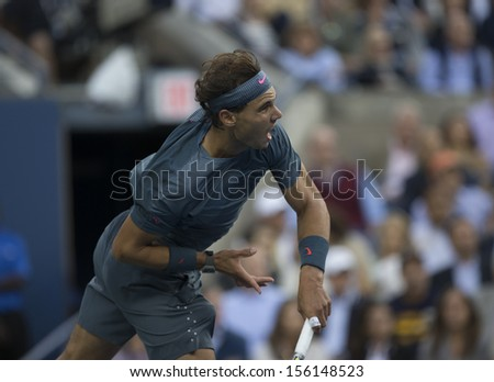 NEW YORK - SEPTEMBER 9: Rafael Nadal of Spain returns ball during US Open final match against Novak Djokovic of Serbia at USTA Billie Jean King National Tennis Center on September 9, 2013 in New York - stock photo