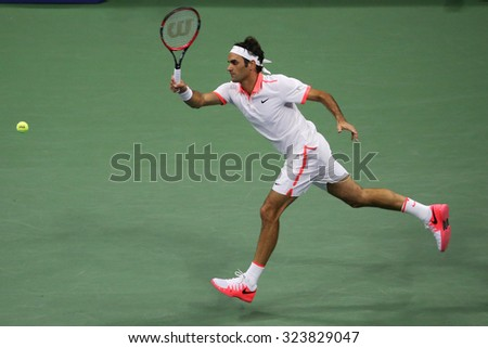 NEW YORK - SEPTEMBER 7, 2015: Seventeen times Grand Slam champion Roger Federer of Switzerland in action during his US Open 2015 match at National Tennis Center in NY - stock photo