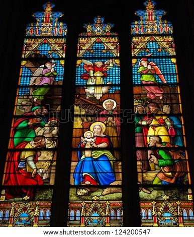 NEW YORK - SEPTEMBER 14: Stained Glass window in St. Patrick's Cathedral in New York City, on September 14, 2012, depicting a Nativity Scene at Christmas. - stock photo